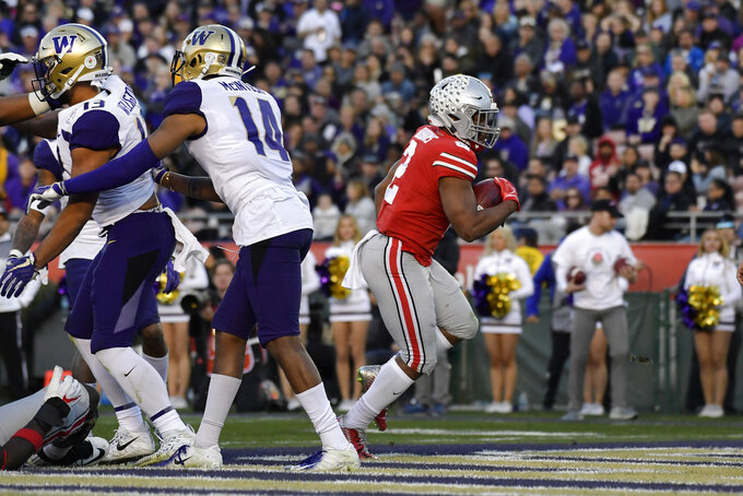 Ohio State running back J.K. Dobbins scores against Washington during the second half of the Rose Bowl NCAA college football game Tuesday, Jan. 1, 2019, in Pasadena, Calif. (AP Photo/Mark J. Terrill)
