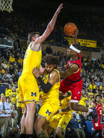 Nebraska guard Glynn Watson Jr., right, has his shot attempt blocked by Michigan center Jon Teske, left, and over forward Isaiah Livers, middle, in the first half of an NCAA college basketball game at Crisler Center in Ann Arbor, Mich., Thursday, Feb. 28, 2019. (AP Photo/Tony Ding)