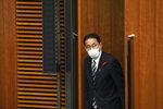 Japanese Prime Minister Fumio Kishida walks for a news conference at the prime minister's official residence Thursday, Oct. 14, 2021, in Tokyo. Kishida dissolved the lower house of parliament Thursday, paving the way for elections Oct. 31 that will be Japan's first of the pandemic. (AP Photo/Eugene Hoshiko, Pool)