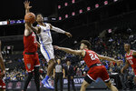 Memphis' Tyler Harris (1) drives past North Carolina State's Pat Andree (31) and Devon Daniels (24) during the first half of an NCAA college basketball game in the Barclays Classic Thursday, Nov. 28, 2019, in New York. (AP Photo/Frank Franklin II)