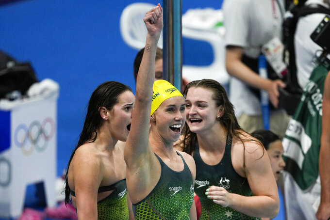 Kaylee McKeown, of Australia, and teammates celebrate winning the gold medal in the women's 4x100-meter medley relay final at the 2020 Summer Olympics, Sunday, Aug. 1, 2021, in Tokyo, Japan. (AP Photo/Jae C. Hong)