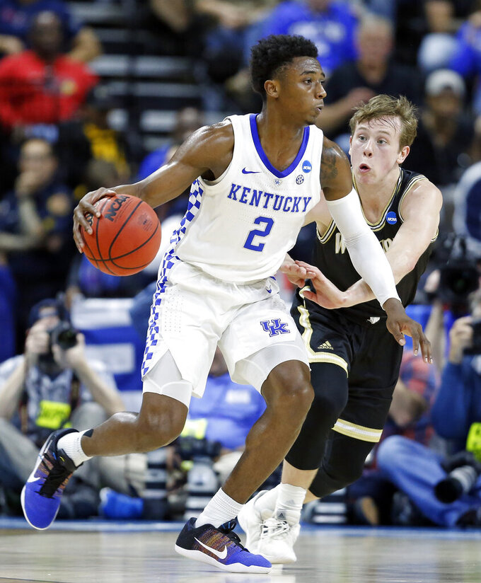 Kentucky's Ashton Hagans (2) drives around Wofford's Storm Murphy during the first half of a second-round game in the NCAA men's college basketball tournament in Jacksonville, Fla., Saturday, March 23, 2019. (AP Photo/Stephen B. Morton)