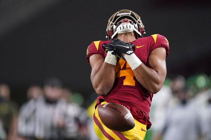 Southern California wide receiver Bru McCoy (4) drops a pass during the fourth quarter of an NCAA college football game for the Pac-12 Conference championship against Oregon Friday, Dec 18, 2020, in Los Angeles. (AP Photo/Ashley Landis)