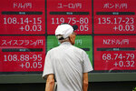 A man watches an electronic board showing currency conversion rates of various countries at a securities firm in Tokyo Wednesday, Sept. 18, 2019. Asian stock prices rose Wednesday after oil prices fell back and Wall Street advanced. (AP Photo/Eugene Hoshiko)