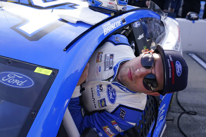Chase Briscoe climbs into his car before qualifications for the NASCAR Series auto race at Indianapolis Motor Speedway, Sunday, Aug. 15, 2021, in Indianapolis. (AP Photo/Darron Cummings)