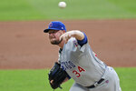 Chicago Cubs starting pitcher Jon Lester deliver in the first inning in a baseball game against the Cleveland Indians, Tuesday, Aug. 11, 2020, in Cleveland. (AP Photo/Tony Dejak)