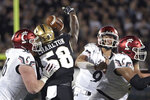 Central Florida defensive lineman Randy Charlton (58) knocks down a pass by Cincinnati quarterback Desmond Ridder (9) at the line of scrimmage during the first half of an NCAA college football game Saturday, Nov. 17, 2018, in Orlando, Fla. (AP Photo/Phelan M. Ebenhack)
