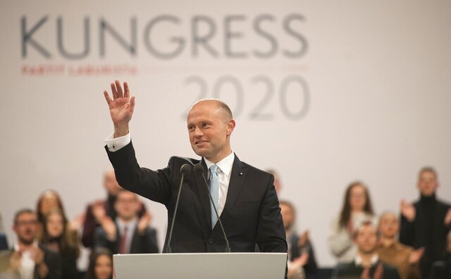 Malta's Prime Minister Joseph Muscat waives during his farewell speech as Labour Party leader in Kordin, near Valletta, Friday, Jan. 10, 2020. A new leader will be elected during the weekend. (AP Photo/Rene Rossignaud)