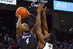 DePaul forward Paul Reed (4) shoots against Butler guard Kamar Baldwin (3) during the first half of an NCAA college basketball game Saturday, Jan. 18, 2020, in Chicago. (AP Photo/Matt Marton)