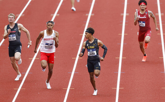 LSU's Terrance Laird, second from right, finishes the final leg of the men's 4x100 relay semifinals during the NCAA Division I Outdoor Track and Field Championships, Wednesday, June 9, 2021, at Hayward Field in Eugene, Ore. (AP Photo/Thomas Boyd)