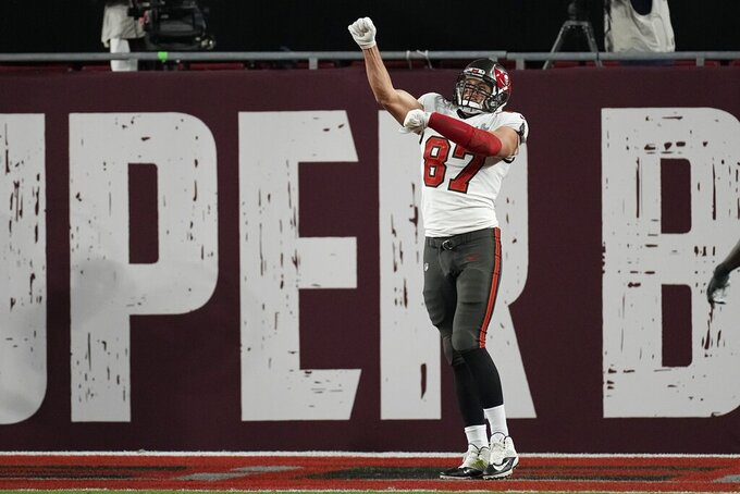 Tampa Bay Buccaneers tight end Rob Gronkowski celebrates after Antonio Brown scored a touchdown against the Kansas City Chiefs during the first half of the NFL Super Bowl 55 football game Sunday, Feb. 7, 2021, in Tampa, Fla. (AP Photo/David J. Phillip)