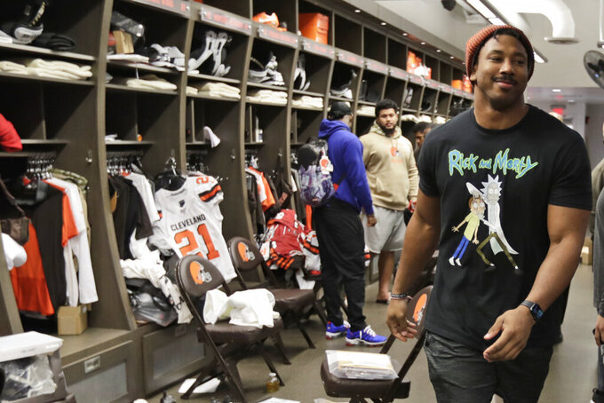 Cleveland Browns defensive end Myles Garrett walks through the locker room at the NFL football team's training camp facility, Monday, Dec. 30, 2019, in Berea, Ohio. Head coach Freddie Kitchens was dismissed shortly after the Browns returned to team headquarters following a 33-23 loss to the lowly Cincinnati Bengals. (AP Photo/Tony Dejak)