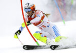 FILE - In this Thursday, Feb. 22, 2018 file photo, Lindsey Vonn competes in the women's combined slalom at the 2018 Winter Olympics in Jeongseon, South Korea. Retirement hasn't slowed down Lindsey Vonn. The all-time winningest female skier in World Cup history has found new adventures like cliff diving with boyfriend and NHL defenseman P.K. Subban, finishing her memoir set to be published next year and serving as an executive producer of a film with Robert Redford. Vonn's never been one to sit back and take it easy. (AP Photo/Luca Bruno, File)