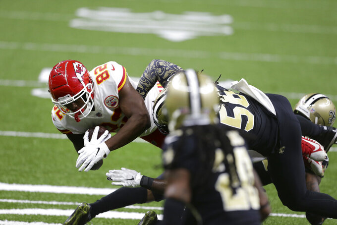 New Orleans Saints outside linebacker Demario Davis (56) tackles Kansas City Chiefs tight end Deon Yelder (82) in the first half of an NFL football game in New Orleans, Sunday, Dec. 20, 2020. (AP Photo/Butch Dill)