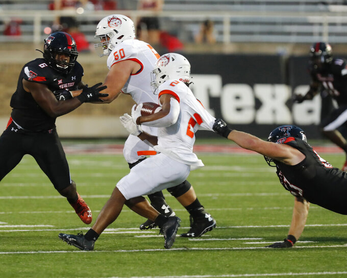 Texas Tech's Eli Howard (53) is called for a horse-collar tackle against Houston Baptist's Ean Beek (2) in the first half of an NCAA college football game, Saturday, Sept. 12, 2020, in Lubbock, Texas. (AP Photo/Mark Rogers)