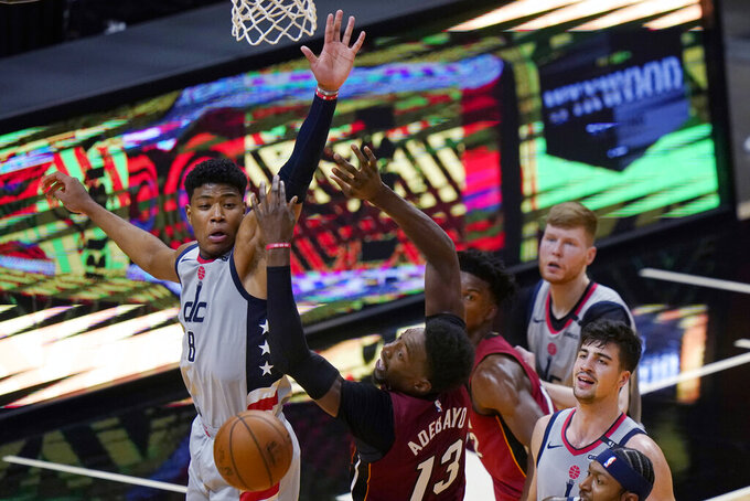 Miami Heat center Bam Adebayo (13) loses control of the ball as Washington Wizards forward Rui Hachimura (8) defends during the first half of an NBA basketball game Wednesday, Feb. 3, 2021, in Miami. (AP Photo/Lynne Sladky)