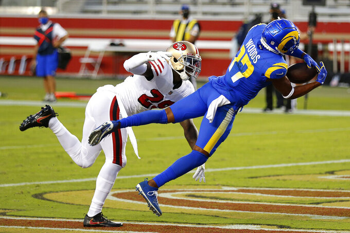 Los Angeles Rams wide receiver Robert Woods (17) catches a touchdown pass in front of San Francisco 49ers strong safety Jaquiski Tartt during the first half of an NFL football game in Santa Clara, Calif., Sunday, Oct. 18, 2020. (AP Photo/Jed Jacobsohn)