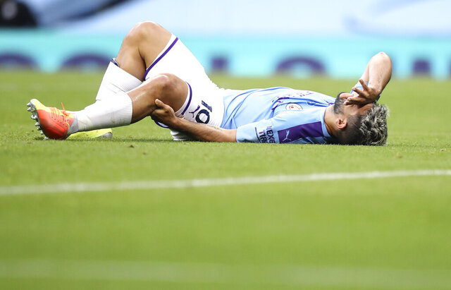 Manchester City's Sergio Aguero reacts as he lies on the pitch injured during the English Premier League soccer match between Manchester City and Burnley at Etihad Stadium, in Manchester, England, Monday, June 22, 2020. (AP Photo/Martin Rickett,Pool)