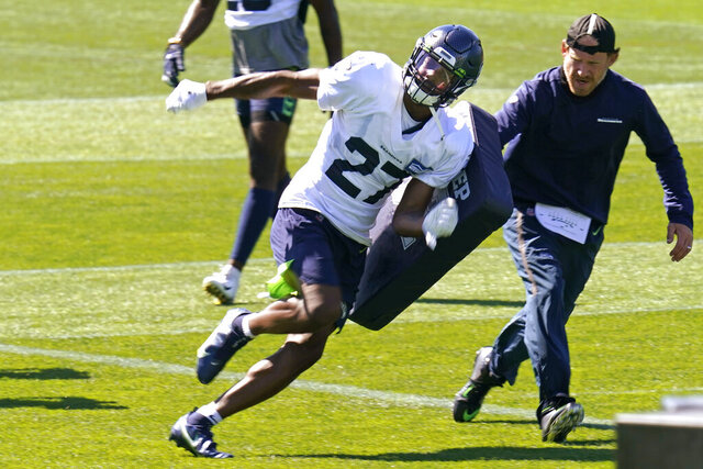 FILE - Seattle Seahawks safety Marquise Blair runs through a drill Sunday, Aug. 30, 2020, during an NFL football training camp in Renton, Wash. The Seattle Seahawks drafted Marquise Blair to be a hard-hitting safety. But right now, the Seahawks see Blair as their best option as a nickel cornerback. It's not an easy transition, but Pete Carroll and his staff have been impressed with what they've seen from Blair so far. (AP Photo/Elaine Thompson, File)