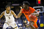 Virginia Tech's Isaiah Wilkins (1) drives past Notre Dame's Prentiss Hubb (3) during the first half of an NCAA college basketball game Saturday, March 7, 2020, in South Bend, Ind. (AP Photo/Robert Franklin)