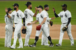 Chicago White Sox players celebrate a 9-5 win over the Chicago Cubs in a baseball game in Chicago, Saturday, Sept. 26, 2020. (AP Photo/Nam Y. Huh)