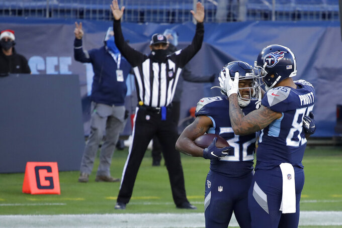 Tennessee Titans running back Darrynton Evans celebrates after scoring with tight end MyCole Pruitt during the second half of an NFL football game against the Detroit Lions Sunday, Dec. 20, 2020, in Nashville, Tenn. (AP Photo/Ben Margot)