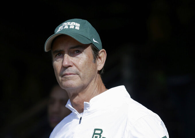 """FILE - In this Dec. 5, 2015, file photo, Baylor coach Art Briles stands in the tunnel before the team's NCAA college football game against Texas in Waco, Texas.  The NCAA infractions committee said Wednesday, Aug. 11, 2021, that its years-long investigation into the Baylor sexual assault scandal would result in four years probation and other sanctions, though the """"unacceptable"""" behavior at the heart of the case did not violate NCAA rules. The NCAA ruling came more than five years after the scandal broke at the world's largest Baptist university, leading to the firing of successful football coach Art Briles, and the later departures of athletic director Ian McCaw and school president Ken Starr.(AP Photo/LM Otero, File)"""