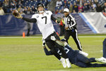 Jacksonville Jaguars quarterback Nick Foles (7) passes as he is dragged down by Tennessee Titans linebacker Harold Landry (58) in the second half of an NFL football game Sunday, Nov. 24, 2019, in Nashville, Tenn. The Titans won 42-20. (AP Photo/Mark Zaleski)