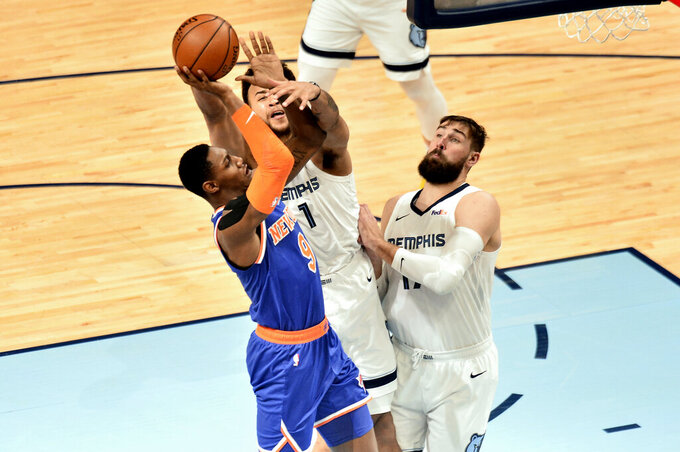 New York Knicks guard RJ Barrett (9) shoots against Memphis Grizzlies forward Kyle Anderson (1) and center Jonas Valanciunas in the second half of an NBA basketball game Monday, May 3, 2021, in Memphis, Tenn. (AP Photo/Brandon Dill)