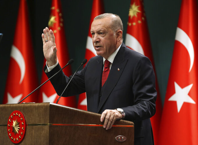 """Turkey's President Recep Tayyip Erdogan, talks in a televised address, following a cabinet meeting, in Ankara, Turkey, Monday, Sept. 21, 2020. Erdogan, who has long called for a reform of the United Nations, says the world body has failed in its response to the coronavirus pandemic. Erdogan claimed the UN was late in """"accepting the existence"""" of the pandemic and had failed to """"make its presence felt"""" for nations requiring help to fight infections. (Turkish Presidency via AP, Pool)"""