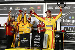 Joey Logano celebrates with his crew after winning the first of the two NASCAR Daytona 500 qualifying auto races at Daytona International Speedway, Thursday, Feb. 13, 2020, in Daytona Beach, Fla. (AP Photo/Terry Renna)