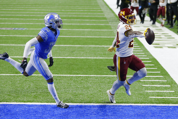 Washington Football Team running back Antonio Gibson (24), chased by Detroit Lions cornerback Jeff Okudah (30), carries the ball into the end zone for a touchdown during the second half of an NFL football game, Sunday, Nov. 15, 2020, in Detroit. (AP Photo/Duane Burleson)
