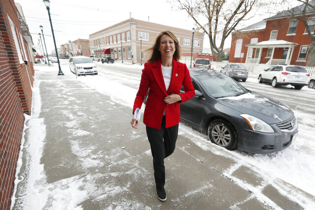 In this Nov. 11, 2019, photo, U.S. Rep. Cindy Axne, D-Iowa, arrives at the American Legion Post 184 to speak to local residents in Winterset, Iowa. Axne defeated a Republican incumbent in 2018 even as she lost 15 of her district's 16 counties. Axne won by offsetting her losses in rural counties with an overwhelming victory in urban Polk County.  (AP Photo/Charlie Neibergall)