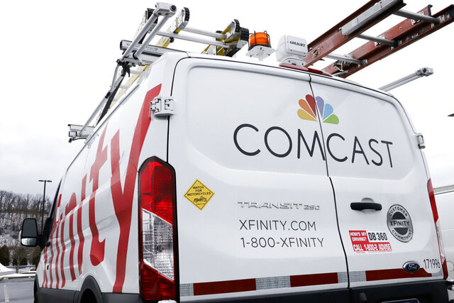 FILE - This Jan. 24, 2019, file photo shows a Comcast truck in Pittsburgh. Comcast Corp. reports financial results Thursday, Jan. 23, 2020. (AP Photo/Gene J. Puskar, File)