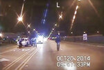 FILE - In this Oct. 20, 2014, image made from dashcam video provided by the Chicago Police Department, Laquan McDonald, 17, right, walks down the street moments before being fatally shot by Chicago Police Officer Jason Van Dyke in Chicago. Dashboard camera footage showed the teen veering away from authorities, images that contradicted officers' claims that he lunged at them with a knife. (Chicago Police Department via AP, File)