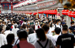 """People wearing face masks pack in a shopping arcade of Asakusa district in Tokyo Sunday, Sept. 20, 2020. Train stations and airports in Japan are filled with people traveling over the """"Silver Week"""" holiday weekend, in a sign of recovery amid the coronavirus pandemic. (Kyodo News via AP)"""