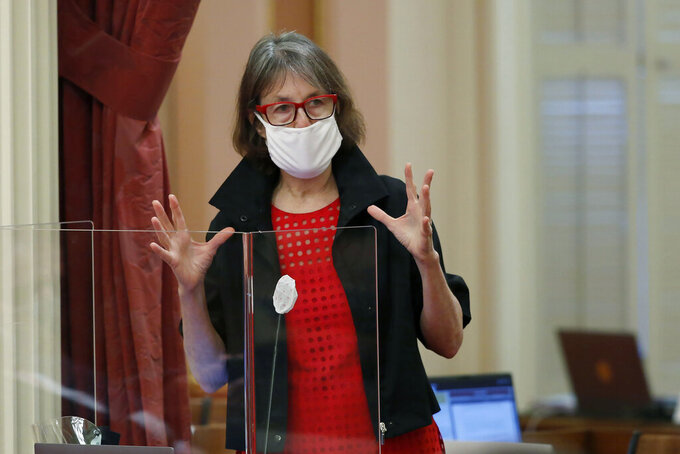 """FILE - In this June 25, 2020, file photo, Sen. Nancy Skinner speaks during debate at the Capitol in Sacramento, Calif. The California Legislature on Thursday, March 18, 2021, voted to expand paid sick leave for about 10.4 million workers, sending a bill to Gov. Gavin Newsom that mandates up to two weeks of paid time off for things like having coronavirus symptoms, scheduling a COVID-19 vaccine or caring for a child who is doing school at home. """"The absolutely best way to contain the spread (of the virus), beyond the fact of wearing masks as we are and keeping our distance, is to ensure people who have COVID or who are asymptomatic with COVID are not going to work,"""" said Sen. Skinner, a Democrat from Berkeley and primary author of the bill. (AP Photo/Rich Pedroncelli, File)"""