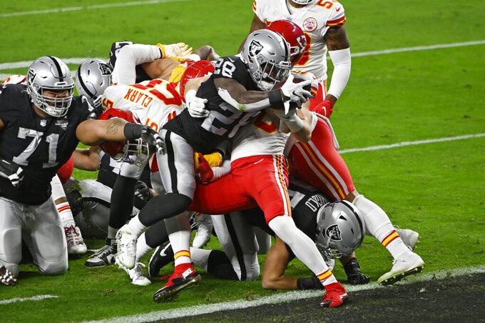 Las Vegas Raiders running back Josh Jacobs (28) scores a touchdown against Kansas City Chiefs linebacker Ben Niemann (56) during the first half of an NFL football game, Sunday, Nov. 22, 2020, in Las Vegas. (AP Photo/David Becker)
