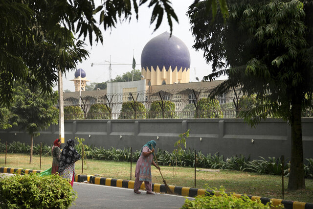"In this Thursday, Nov. 3, 2016, file photo, an Indian municipal worker sweeps the road outside the Pakistan High Commission in New Delhi, India. India has ordered Pakistan to halve its embassy staff in New Delhi and said it would do the same in Islamabad after two Indian officials were abducted at gunpoint in Pakistan, the Indian foreign ministry said Tuesday, June 23, 2020. India's Ministry of External Affairs said the abducted officials returned to India on June 22, describing ""graphic details of the barbaric treatment that they experienced at the hands of Pakistani agencies."" (AP Photo/Altaf Qadri, File)"