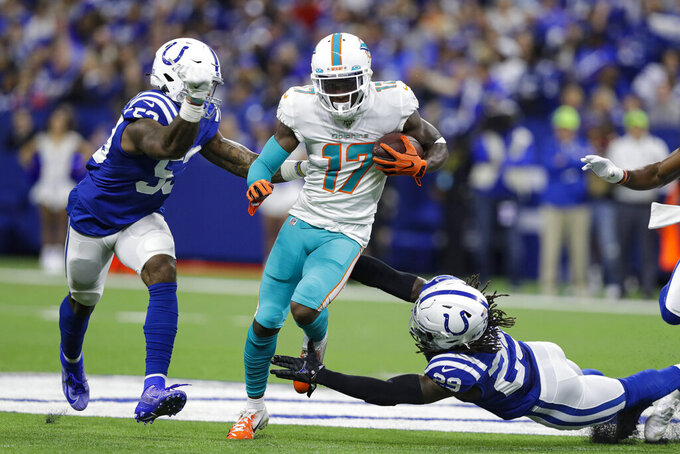 Miami Dolphins wide receiver Allen Hurns (17) is tackled by Indianapolis Colts free safety Malik Hooker (29) and outside linebacker Darius Leonard (53) during the first half of an NFL football game in Indianapolis, Sunday, Nov. 10, 2019. (AP Photo/Darron Cummings)