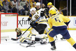 Boston Bruins center David Krejci, of the Czech Republic, clears the puck as goaltender Tuukka Rask (40), of Finland, falls on his back in the second period of an NHL hockey game between the Bruins and the Nashville Predators Tuesday, Jan. 7, 2020, in Nashville, Tenn. (AP Photo/Mark Humphrey)