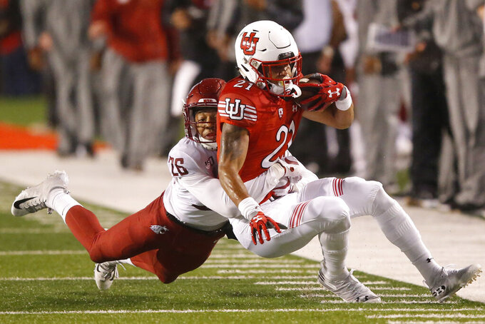 Washington State safety Bryce Beekman (26) tackles Utah wide receiver Solomon Enis (21) in the first half of an NCAA college football game Saturday, Sept. 28, 2019, in Salt Lake City. (AP Photo/Rick Bowmer)