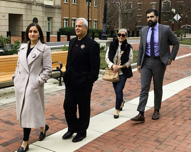 """FILE - From left, Negeen Ghaisar, James Ghaisar, Kelly Ghaisar and Kouros Emami, family of Bijan Ghaisar walk outside federal court in Alexandria, Va., on Friday, March 6, 2020. Two U.S. Park Police officers say they gave """"chance after chance"""" to a northern Virginia man in a stop-and-go police chase before firing 10 shots that killed him in 2017. Documents made public Tuesday, Sept. 15, 2020 in a civil suit filed by the parents of 25-year-old Bijan Ghaisar provide the first real insight into the thought process of the two officers who shot and killed Ghaisar after a chase on the George Washington Parkway. (AP Photo/Matthew Barakat)"""