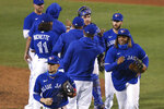 Toronto Blue Jays celebrate a 5-2 win over the Baltimore Orioles in a baseball game Saturday, Sept. 26, 2020, in Buffalo, N.Y. (AP Photo/Jeffrey T. Barnes)