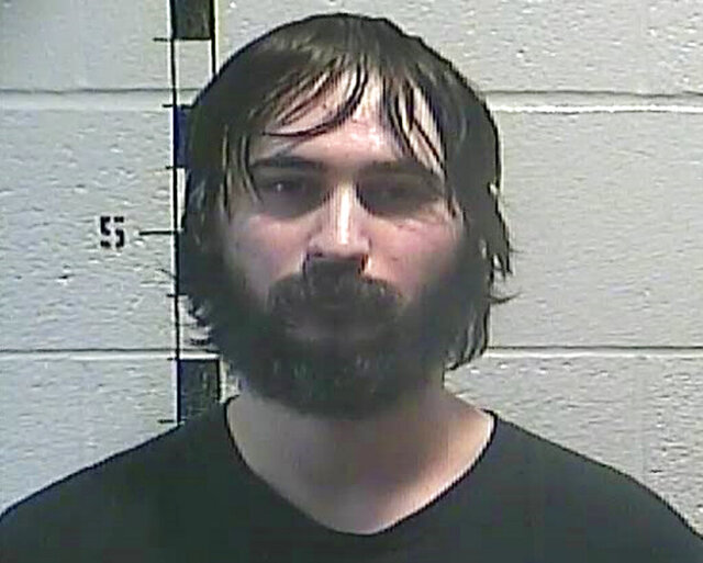 FILE - This undated file photo released by the Shelby County Detention Center in Shelbyville Ky., shows Dylan Jarrell, who has been charged with harassing communications and terroristic threatening in relation to a threat against schools in Shelby and Anderson counties. The  Kentucky man who pleaded guilty to threatening to shoot someone at a high school has been sentenced. WKYT-TV cited a statement from the U.S. Attorney's Office in reporting that Jarrell was sentenced on Wednesday, July 8, 2020, to 10 years in prison followed by five years of supervised released.(Shelby County Detention Center via AP, File)