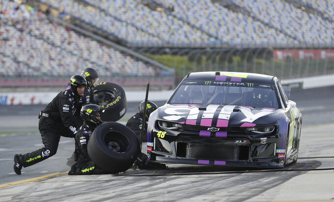 Crew members perform a pit stop on driver Jimmie Johnson's car during qualifying for Saturday's NASCAR All-Star Cup series auto race at Charlotte Motor Speedway in Concord, N.C., Friday, May 17, 2019. (AP Photo/Chuck Burton)