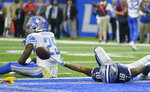 Dallas Cowboys wide receiver Randall Cobb (18) reacts after a touchdown while defended by Detroit Lions defensive back Will Harris (25) during the first half of an NFL football game, Sunday, Nov. 17, 2019, in Detroit. (AP Photo/Duane Burleson)