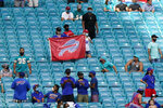 Buffalo Bills fans celebrate their team during the second half of an NFL football game against the Miami Dolphins, Sunday, Sept. 20, 2020 in Miami Gardens, Fla. The Bills defeated the Dolphins 31-28. (AP Photo/Wilfredo Lee)