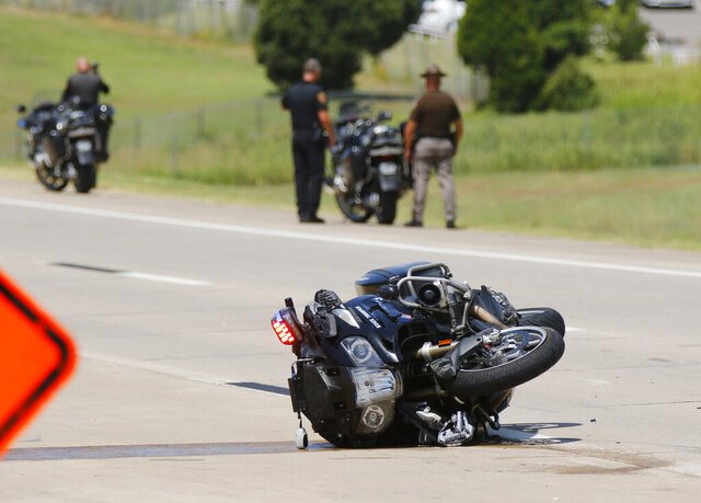The procession for fallen Tulsa Police Sgt. Craig Johnson has been involved in a collision in the westbound lanes of the Kilpatrick Turnpike, Thursday, July 2, 2020, in Oklahoma City. Three troopers in the Oklahoma Highway Patrol Motorcycle Division were injured Thursday. (Doug Hoke/The Oklahoman via AP)