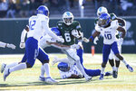 Tulane running back Corey Dauphine (6) splits Tulsa defenders during an NCAA college football game in New Orleans, La., Saturday, Nov. 2, 2019. (A.J. Sisco/The Advocate via AP)